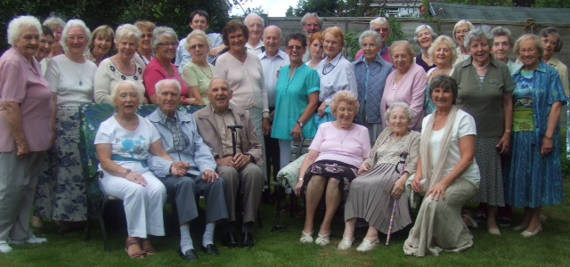Annual summer  choir coffee morning in the garden of a member's house some years ago